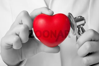 Red heart shape and stethoscope in a doctor's hand