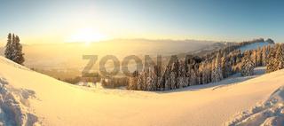 Beautiful Sunrise in snow mountains landscape. Amazing yellow Sunshine. Allgau, Mittag Mountain, Bavaria, Alps, Germany.