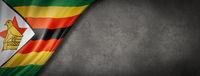 Zimbabwe flag on concrete wall banner