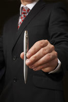 Businessman holding pen