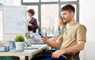 man with smartphone at office conference