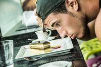 Attractive Young Man's Breakfast, Eating Cake at Diner