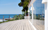 Fenced restaurant terraced area with sea view. Spain