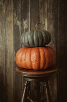 Colored pumpkins against wood background