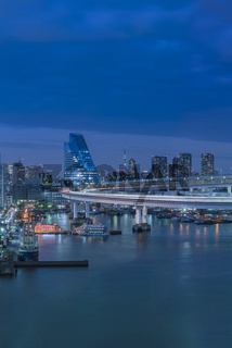 Blue night view on circular highway leading to the Rainbow Bridge with Cargo and
