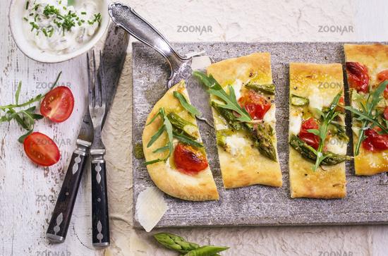 tarte flambee with mozzarella and arugula
