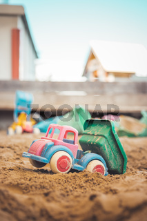 Childhood sandbox concept: Close up of plastic toy truck