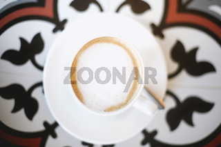 Cups with coffee on tiled table