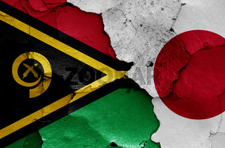 flags of Vanuatu and Japan painted on cracked wall