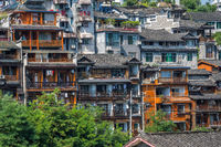 Facades of old historic wooden Diaojiao houses in Fenghuang