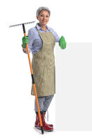 Woman gardener with rake and banner