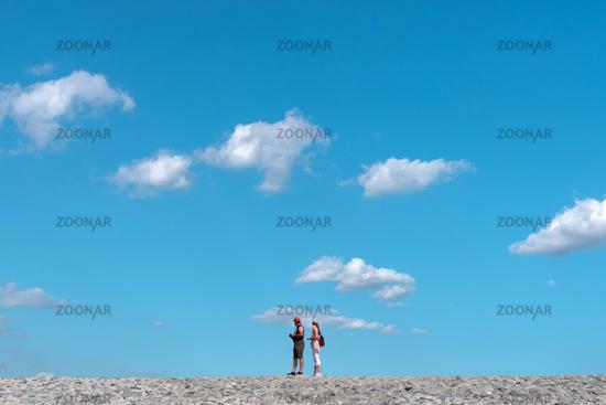Tourists on the dam by Bensersiel
