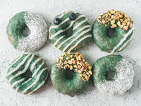 Vegan donuts topped spirulina glaze