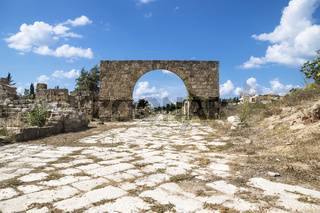 Byzantine road with triumph arch with blue sky in ruins of Tyre, Lebanon