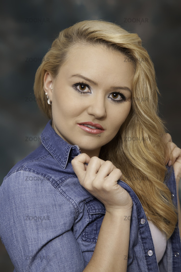 Portrait of a young blond woman in a jeansshirt