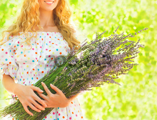 Woman with long blond hair with lavender bouquet
