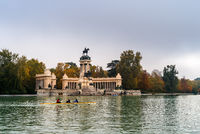 Amateur people canoeing in the Pond of Buen Reiro Park in Madrid during Fall