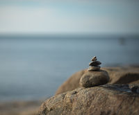 Cairn on a rock by the sea