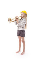 young girl with yellow helmet plays trumpet in studio against white background