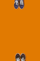 Top view of people feet on the orange background as a social distancing.