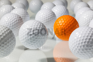 Many golf balls on a glass table