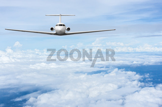 Airliner fly over clouds