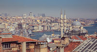 Touristic sightseeing ships in Golden Horn bay of Istanbul and view on Suleymaniye mosque with Sultanahmet district against blue sky and clouds