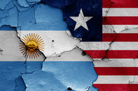 flags of Argentina and Liberia painted on cracked wall