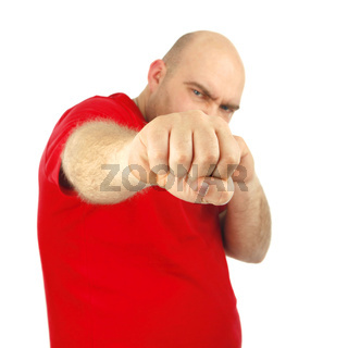 Close up portrait of a aggressive man showing his fist