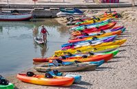 Multi-colored kayaks on the Langeron Beach