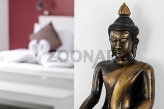 bronze buddha statue interior design detail in modern asian home