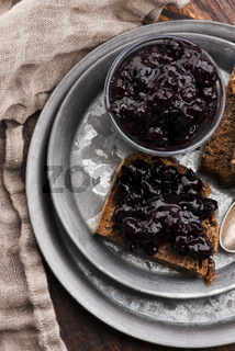 Bread with blueberry jam on the plate