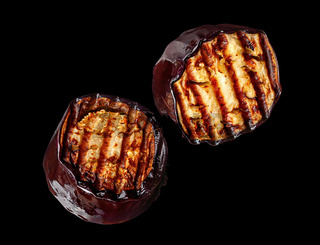 Two pieces of grilled eggplant rotate