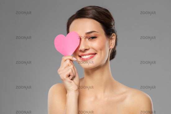 beautiful woman closing one eye with pink heart