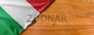 National flag of Italy on a wooden background with copy space