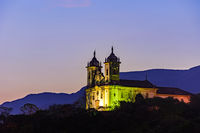 Night view of the historic 18th century church and hills at Ouro Preto city