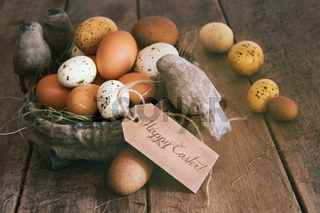 Assorted eggs in basket with note card