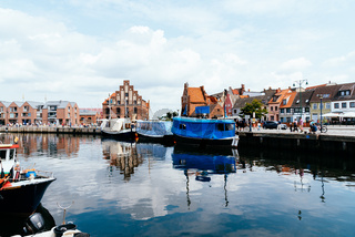 Boats selling fresh food in the Old Hansa Harbor of Wismar, Germany