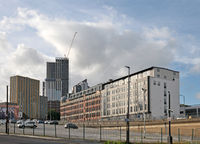 car park on new york road in leeds looking towards north street and the apartment developments around the arena