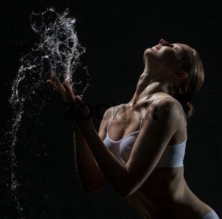 Sexy blonde in white lingerie in studio aquazone