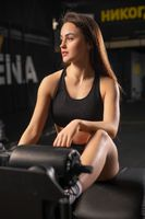 Young brunette in a gym portrait