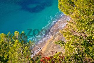 French riviera. Idyllic Cote d'Azur hidden beach in pine trees aerial view