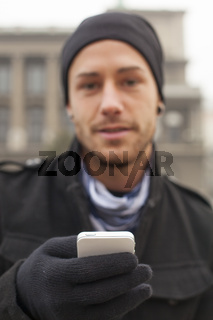Man with mobile phone in hands
