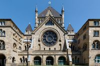the old synagogue in cologne at a sunny day against clear blue sky