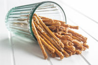Salty sticks. Crunchy pretzels in glass.