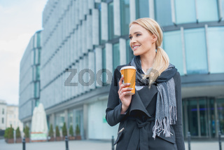 Businesswoman Outside Building with Coffee