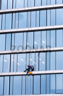 Window cleaner working on a glass facade