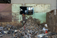 Discarded metal from reclaimed wood processing