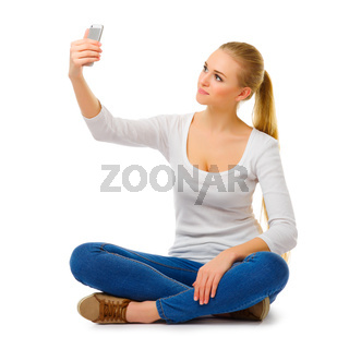 Surprised girl with mobile phone isolated