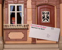 Eviction notice envelope being delivered to toy dolls house with notice to quit